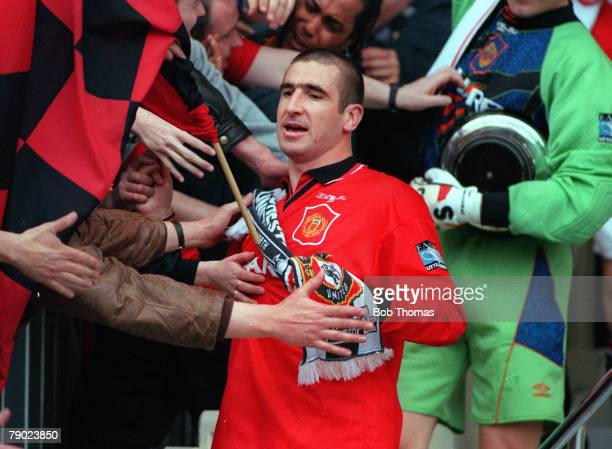 Football 1996 FA Cup Final Wembley 11th May Manchester United 1 v Liverpool 0 Manchester United's captain Eric Cantona is touched by jubilant...