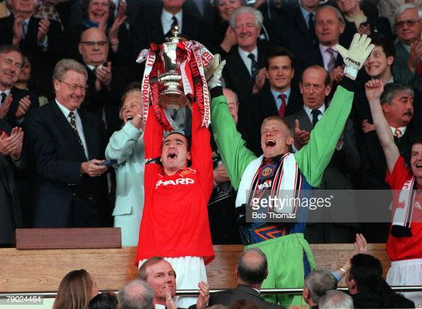 Football 1996 FA Cup Final Wembley 11th May Manchester United 1 v Liverpool 0 Manchester United's captain Eric Cantona proudly holds aloft the trophy...