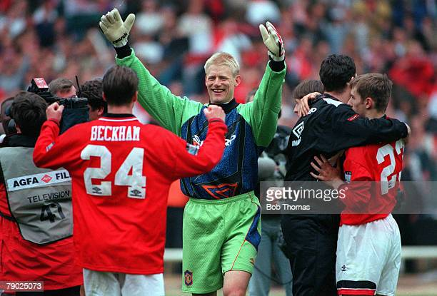 Football 1996 FA Cup Final Wembley 11th May Manchester United 1 v Liverpool 0 Manchester United goalkeeper Peter Schmeichel celebrates with David...