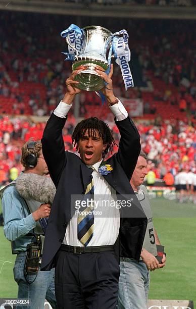 Football 1997 FA Cup Final Wembley 17th May Chelsea 2 v Middlesbrough 0 Chelsea's manager Ruud Gullit proudly holds aloft the trophy after the...