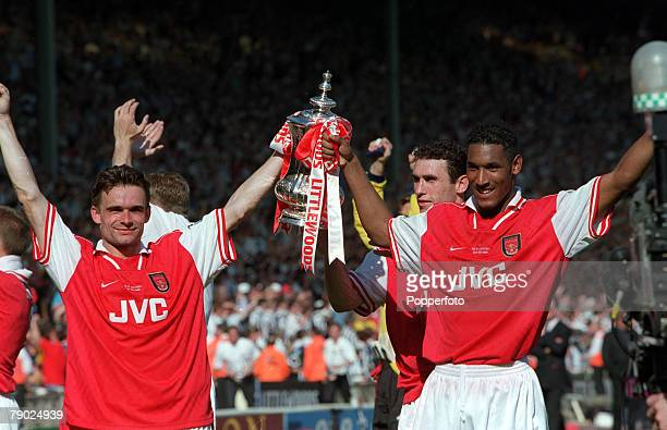 Football 1998 FA Cup Final Wembley 16th May Arsenal 2 v Newcastle United 0 Arsenal goalscorers Marc Overmars and Nicolas Anelka celebrate with the FA...
