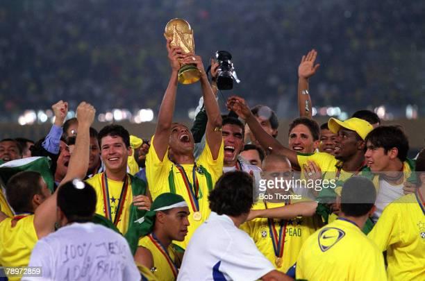 Football 2002 FIFA World Cup Final Yokohama Japan 30th June 2002 Brazil 2 v Germany 0 Brazil's Gilberto Silva holds the World Cup trophy aloft as he...
