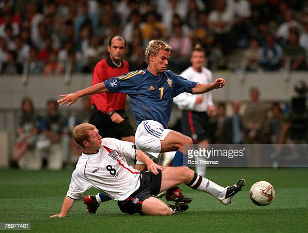 Football 2002 FIFA World Cup Finals Group F Saitama Japan 2nd June 2002 England 1 v Sweden 1 Sweden's Niclas Alexandersson is tackled by England's...