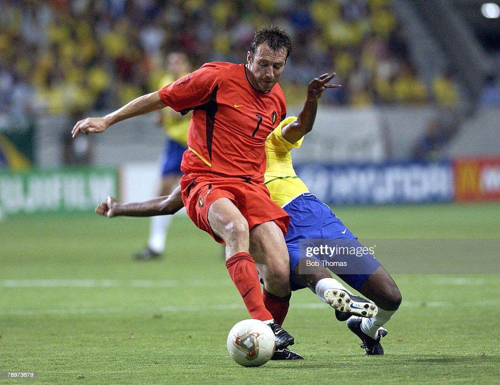 Football, 2002 FIFA World Cup Finals, Kobe, Japan, 17th June 2002, Brazil 2 v Belgium 0, Brazil's Roque Junior challenges Belgium's <a gi-track='captionPersonalityLinkClicked' href=/galleries/search?phrase=Marc+Wilmots&family=editorial&specificpeople=1016207 ng-click='$event.stopPropagation()'>Marc Wilmots</a>