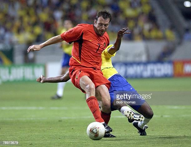 Football 2002 FIFA World Cup Finals Kobe Japan 17th June 2002 Brazil 2 v Belgium 0 Brazil's Roque Junior challenges Belgium's Marc Wilmots