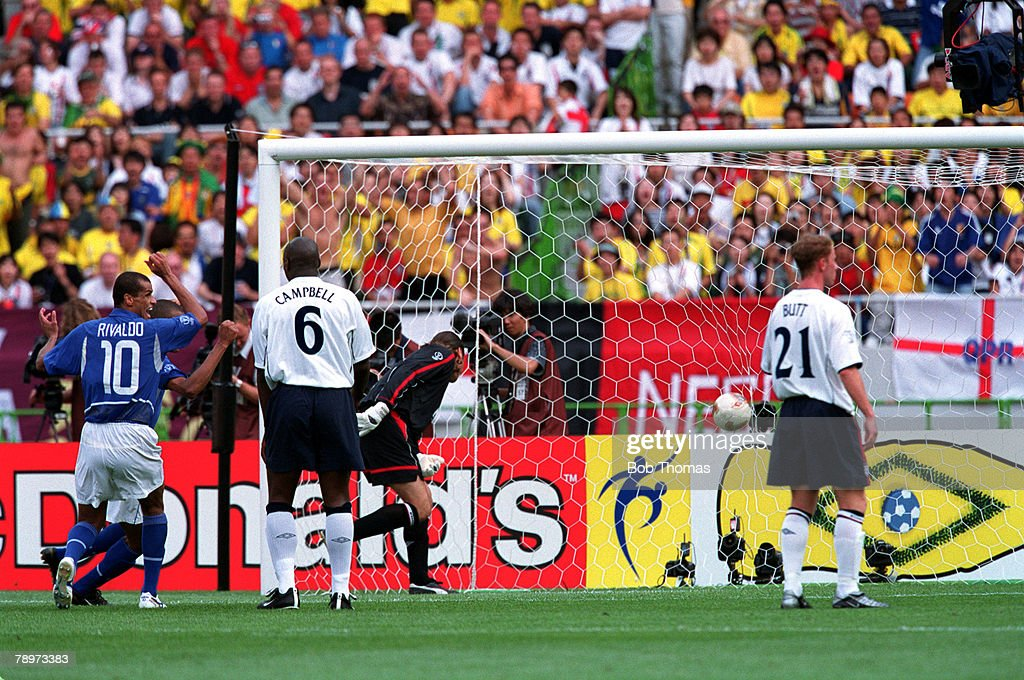 Football, 2002 FIFA World Cup Finals, Quarter Finals, Shizuoka, Japan, 21st June 2002, England 1 v Brazil 2, Brazil's Ronaldinho has scored the winning goal from a direct free-kick past England goalkeeper David Seaman,Credit: POPPERFOTO