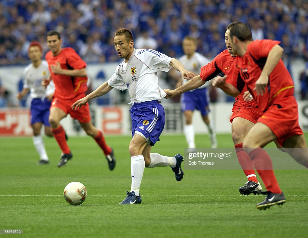 Football, 2002 FIFA World Cup Finals, Saitama, Japan, 4th June 2002, Japan 2 v Belgium 2, Japan's Hidetoshi Nakata passes the challenge of Belgium's <a gi-track='captionPersonalityLinkClicked' href=/galleries/search?phrase=Marc+Wilmots&family=editorial&specificpeople=1016207 ng-click='$event.stopPropagation()'>Marc Wilmots</a>