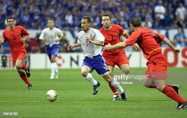 Football 2002 FIFA World Cup Finals Saitama Japan 4th June 2002 Japan 2 v Belgium 2 Japan's Hidetoshi Nakata passes the challenge of Belgium's Marc...