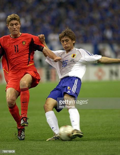 Football 2002 FIFA World Cup Finals Saitama Japan 4th June 2002 Japan 2 v Belgium 2 Koji Nakata of Japan with Belgium's Gert Verheyen