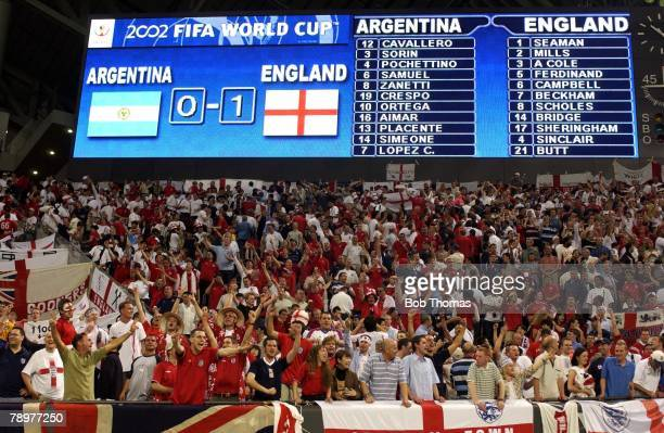 Football 2002 FIFA World Cup Finals Sapporo Japan 7th June 2002 Argentina 0 v England 1 England fans celebrate beneath the electronic scoreboard as...