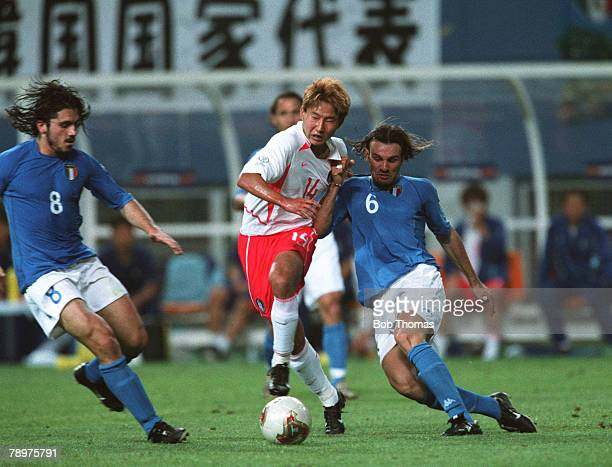 Football 2002 FIFA World Cup Finals Second Phase Daejeon South Korea 18th June 2002 South Korea 2 v Italy 1 South Korea's Chun Soo Lee is challenged...