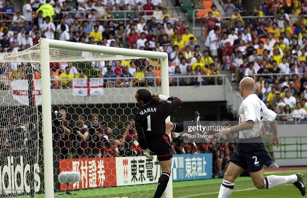 Football, 2002 FIFA World Cup Finals, Shizuoka, Japan, 21st June 2002, England 1 v Brazil 2, England goalkeeper David Seaman looks back into his goal as Brazil's Ronaldinho scores from a free kick