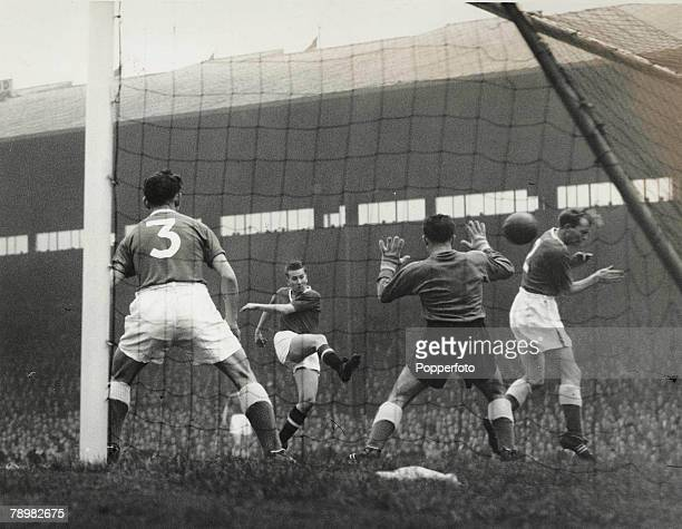 Football 20th October 1956 Old Trafford Manchester Manchester United 2 v Everton 5 Everton right back Donovan ducks away from a fierce goalbound shot...