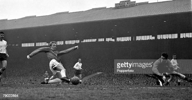 Football 26th March 1963 Old Trafford England Division One Manchester United v Tottenham Hotspur Manchester Uniteds Denis Law fires a shot at the...