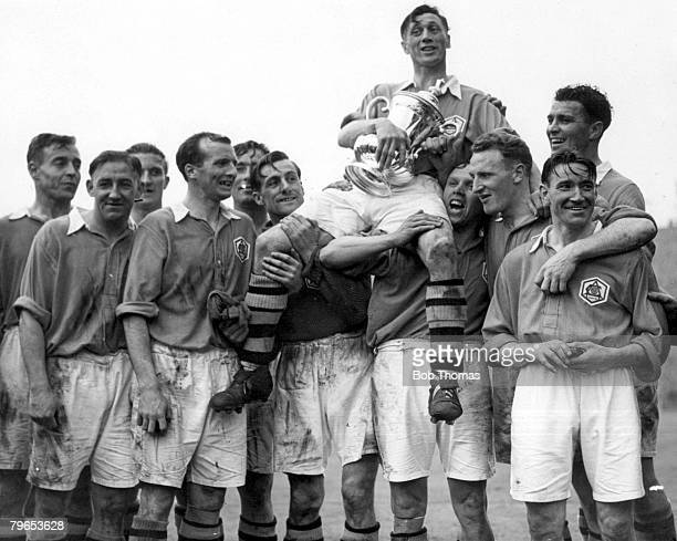 Football 29th April FA Cup Final Wembley Stadium Arsenal 2 v Liverpool 0 Arsenal captain Joe Mercer holds aloft the trophy as he is chaired on the...