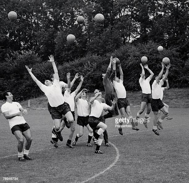 Football 2nd August 1963 Tottenham Hotspur players leap and jump in the air catching balls as they enjoy pre season training