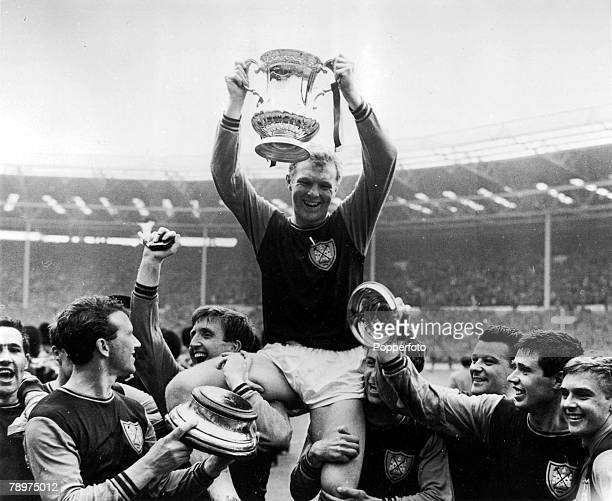 Football 2nd May 1964 Wembley Stadium London FA Cup Final West Ham United 3 v Preston North End 2 West Ham United captain Bobby Moore holds aloft the...