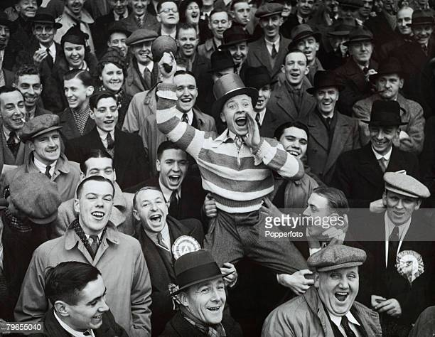 Football 8th January 1938 Highbury London England FA Cup Third Round Arsenal v Bolton Wanderers An Arsenal supporter is pictured cheering his team on...