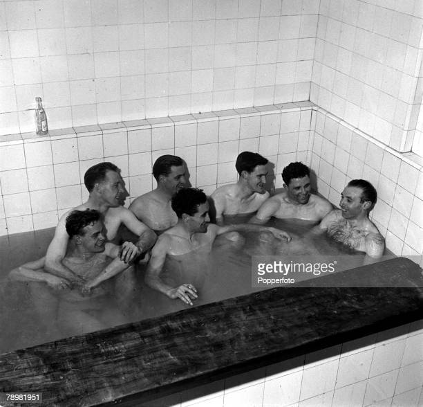 Football A group of Blackpool players enjoy aa relaxing bath after the game they include Stanley Matthews Ernest Taylor and Cole