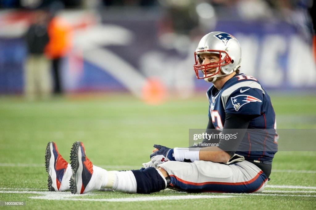 New England Patriots QB Tom Brady (12) down on turf during game vs Baltimore Ravens at Gillette Stadium. Al Tielemans F90 )