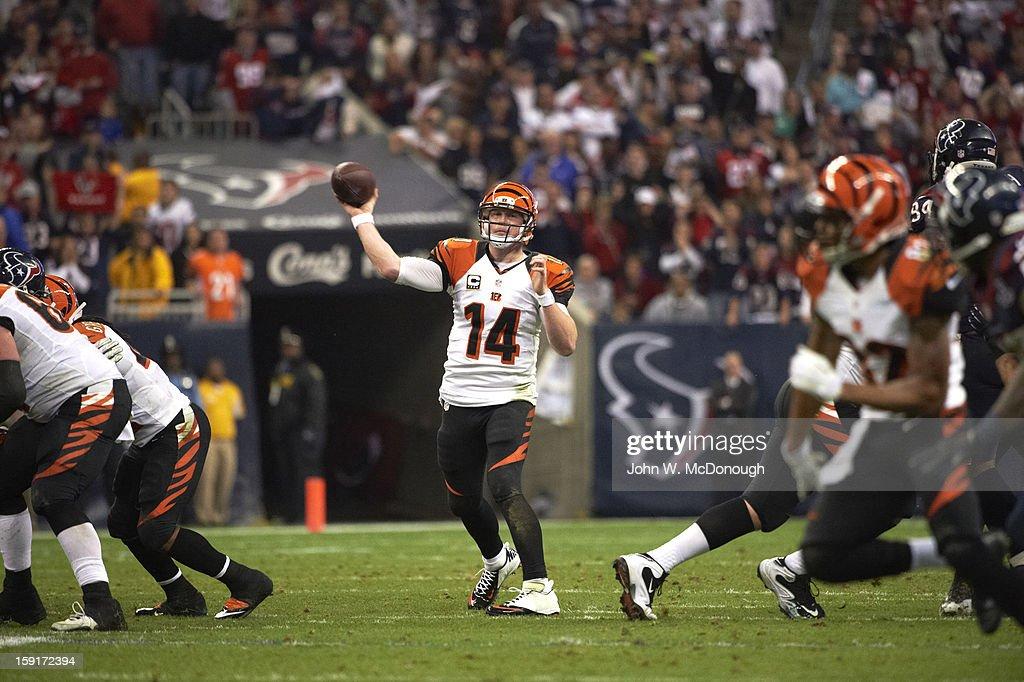 Cincinnati Bengals QB Andy Dalton (14) in action, making pass vs Houston Texans at Reliant Stadium. John W. McDonough F650 )