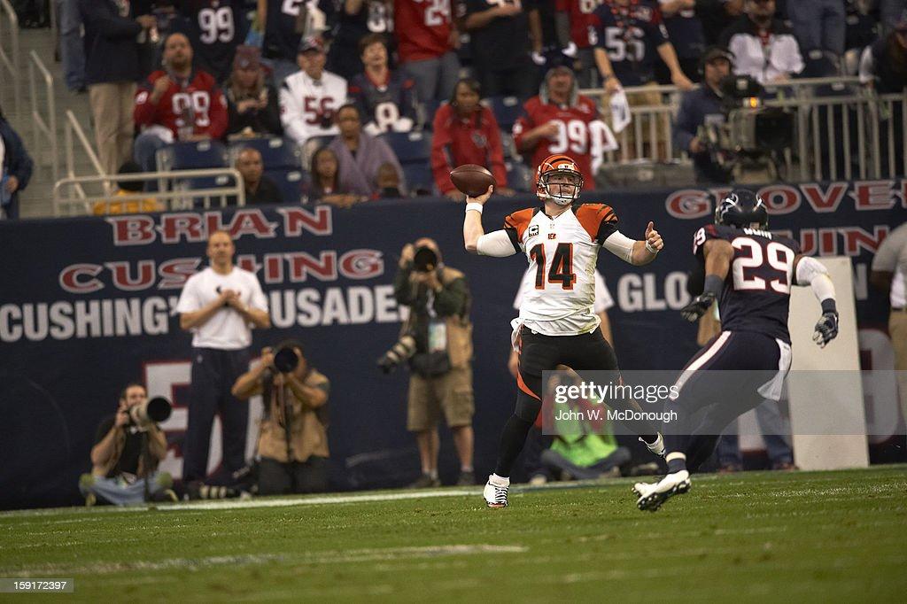 Cincinnati Bengals QB Andy Dalton (14) in action, making pass vs Houston Texans at Reliant Stadium. John W. McDonough F32 )