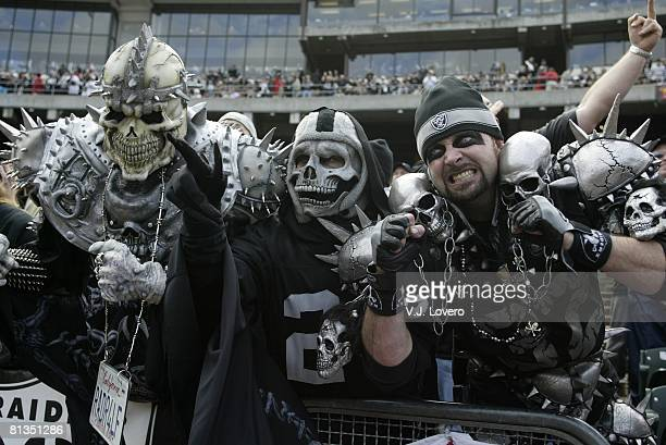 Football AFC playoffs Closeup of painted Oakland Raiders fans in Black Hole during game vs New York Jets Oakland CA 1/12/2003