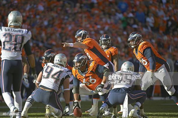 AFC Playoffs Denver Broncos QB Peyton Manning under center Manny Ramirez at line of scrimmage during game vs New England Patriots at Sports Authority...
