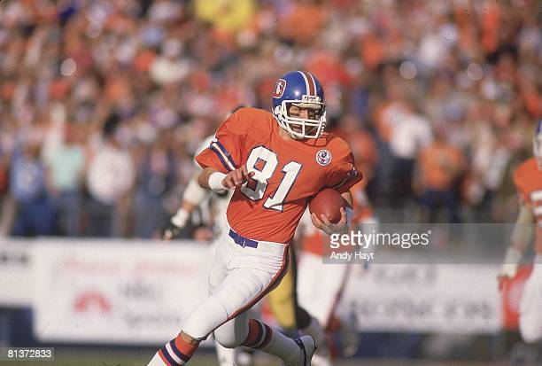Football AFC Playoffs Denver Broncos Steve Watson in action rushing vs Pittsburgh Steelers Denver CO