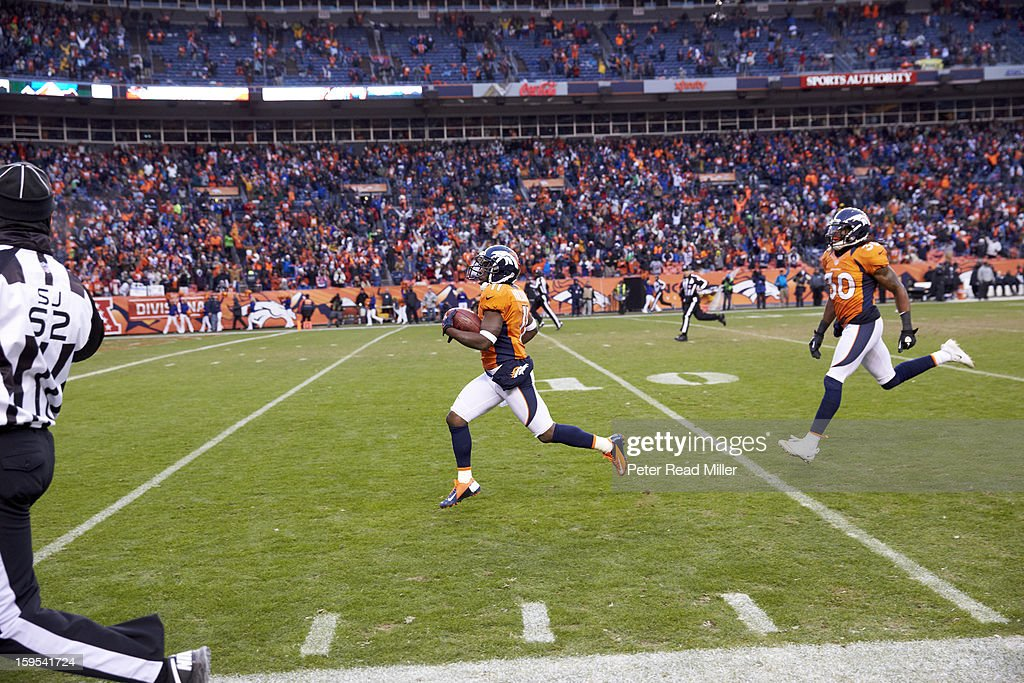 Denver Broncos Trindon Holliday (11) in action during punt return for touchdown vs Baltimore Ravens at Sports Authority Field at Mile High. Peter Read Miller F1513 )