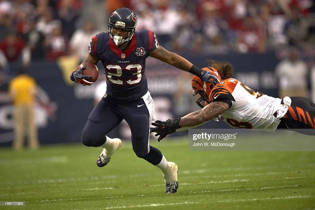 Houston Texans Arian Foster (23) in action, rushing vs Cincinnati Bengals at Reliant Stadium. John W. McDonough F96 )