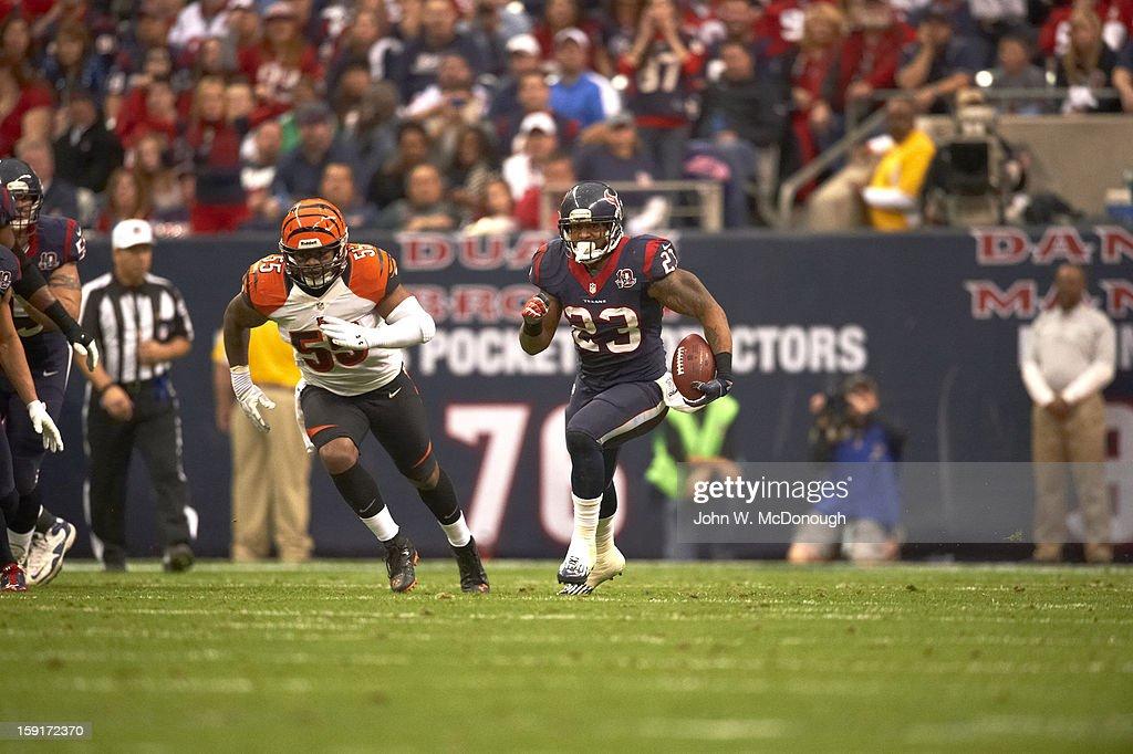 Houston Texans Arian Foster (23) in action, rushing vs Cincinnati Bengals at Reliant Stadium. John W. McDonough F243 )
