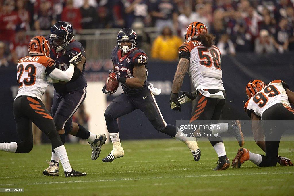 Houston Texans Arian Foster (23) in action, rushing vs Cincinnati Bengals at Reliant Stadium. John W. McDonough F316 )
