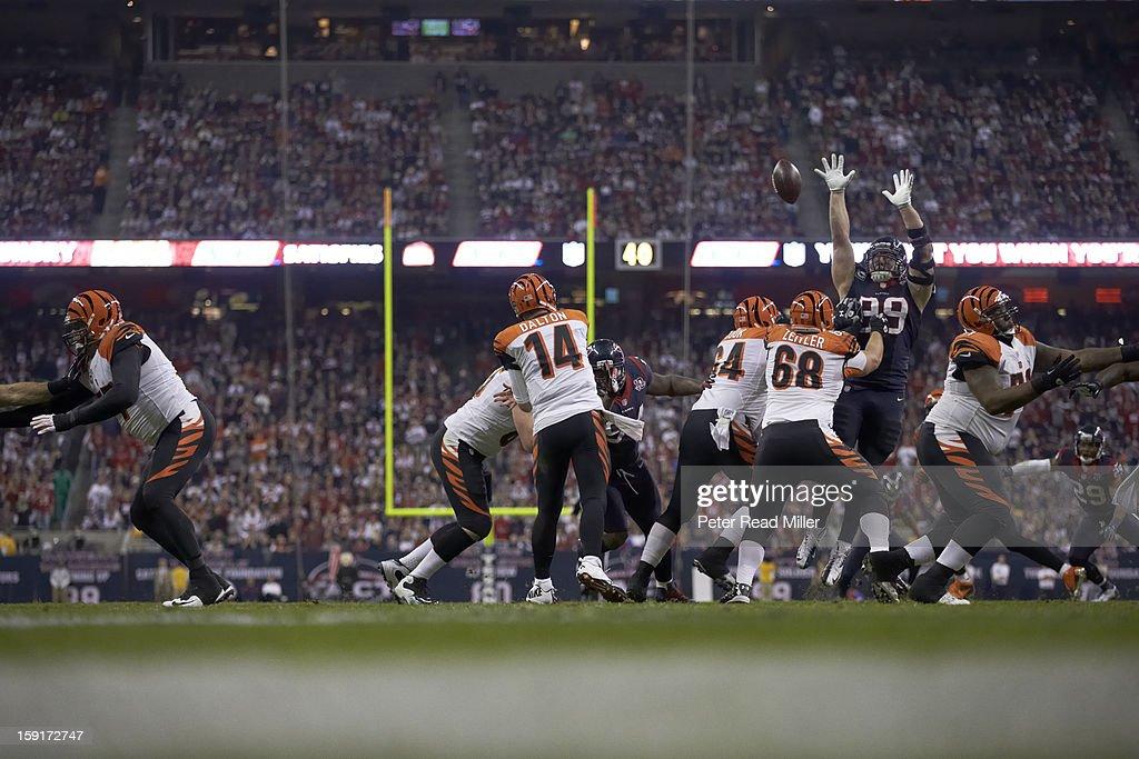 Houston Texans J.J. Watt (99) in action, defense, knocking down pass vs Cincinnati Bengals QB Andy Dalton (14) at Reliant Stadium. Peter Read Miller F1227 )