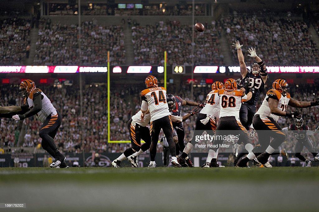 Houston Texans J.J. Watt (99) in action, knocking down pass by Cincinnati Bengals QB Andy Dalton (14) at Reliant Stadium. Peter Read Miller F1228 )