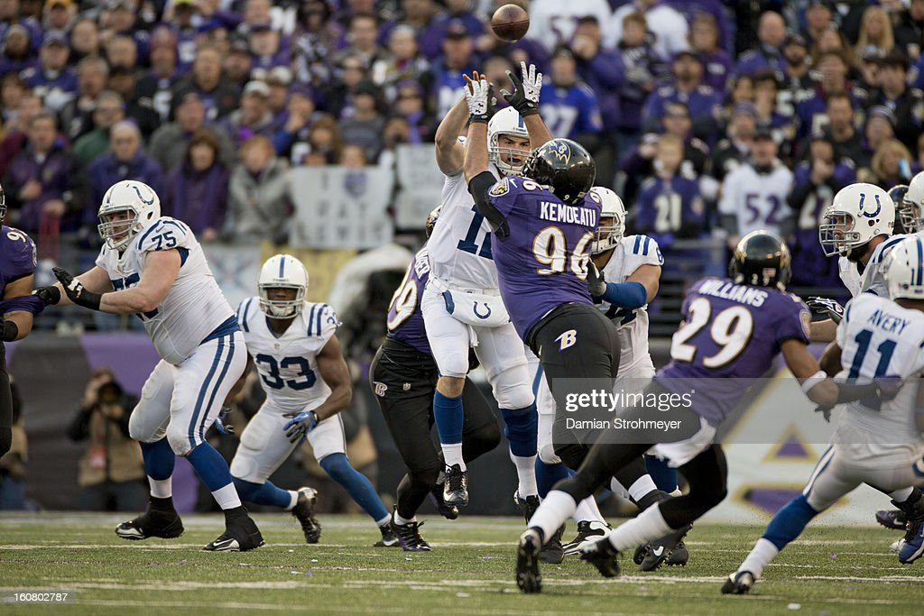 Indianapolis Colts QB Andrew Luck (12) in action, making pass under pressure from Baltimore Ravens Ma'ake Kemoeatu (96) at M&T Bank Stadium. Damian Strohmeyer F50 )