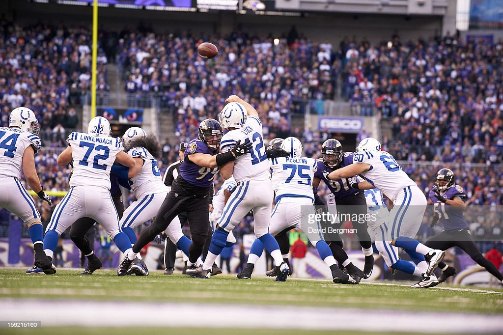 Indianapolis Colts QB Andrew Luck (12) in action vs Baltimore Ravens Paul Kruger (99) at M&T Bank Stadium. David Bergman F23 )