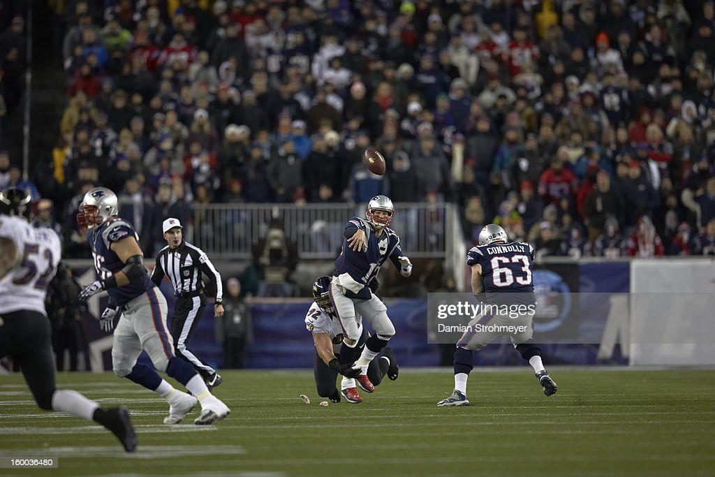 New England Patriots QB Tom Brady (12) in action, passing vs Baltimore Ravens Haloti Ngata (92) at Gillette Stadium. Damian Strohmeyer F129 )