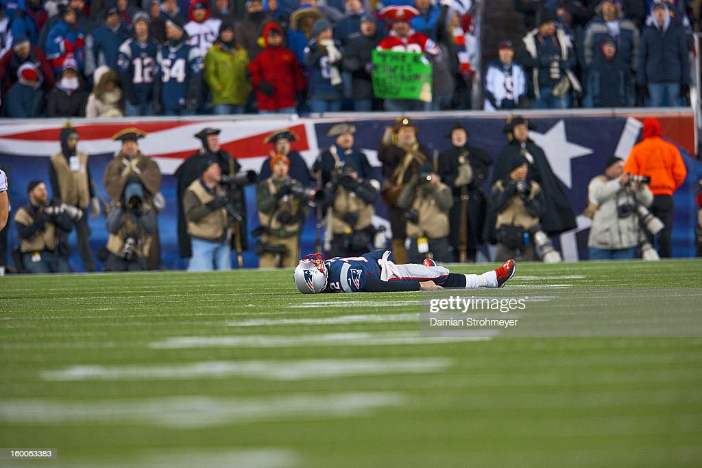 New England Patriots QB Tom Brady (12) lying on the field near the end of the game vs Baltimore Ravens at Gillette Stadium. Damian Strohmeyer F123 )