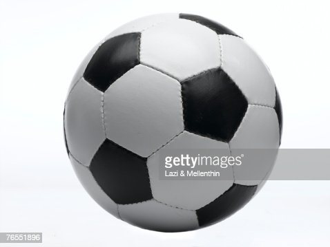 Football against white background, close-up