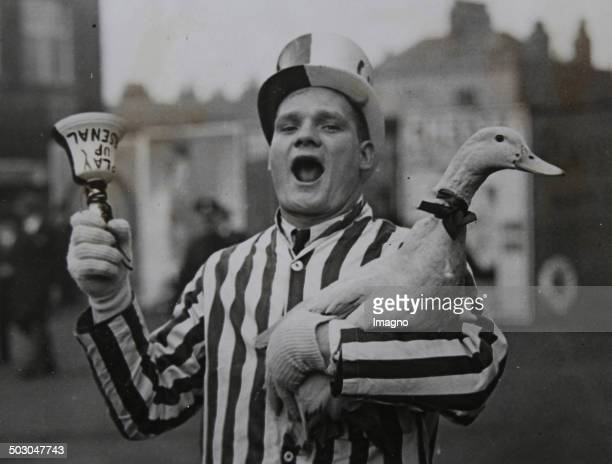 Football An Arsenal's fan is carring his duckmascot before the cupplay In the background the Stamford Bridge stadium that is the home ground of...