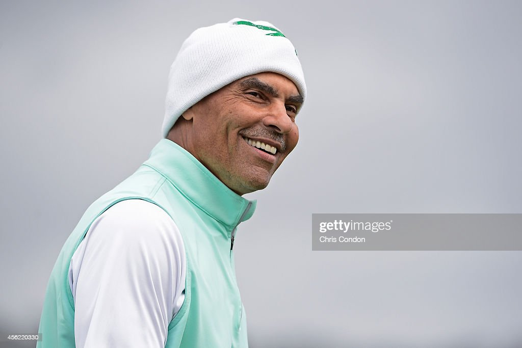 ESPN football analyst Herman Edwards walks to the 18th green during the second round of the Champions Tour Nature Valley First Tee Open at Pebble...