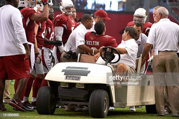 Arizona Cardinals QB John Skelton being carted off field with injury during game vs Seattle Seahawks at University of Phoenix Stadium Glendale AZ...