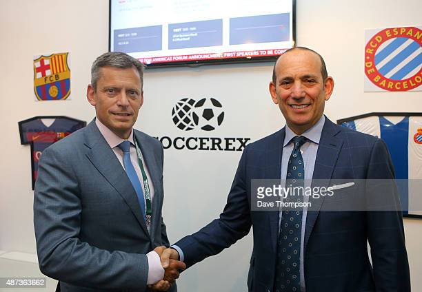 Football Association Chief Executive Martin Glenn left shakes hands with Major League Soccer Commissioner Don Garber during day five of the Soccerex...