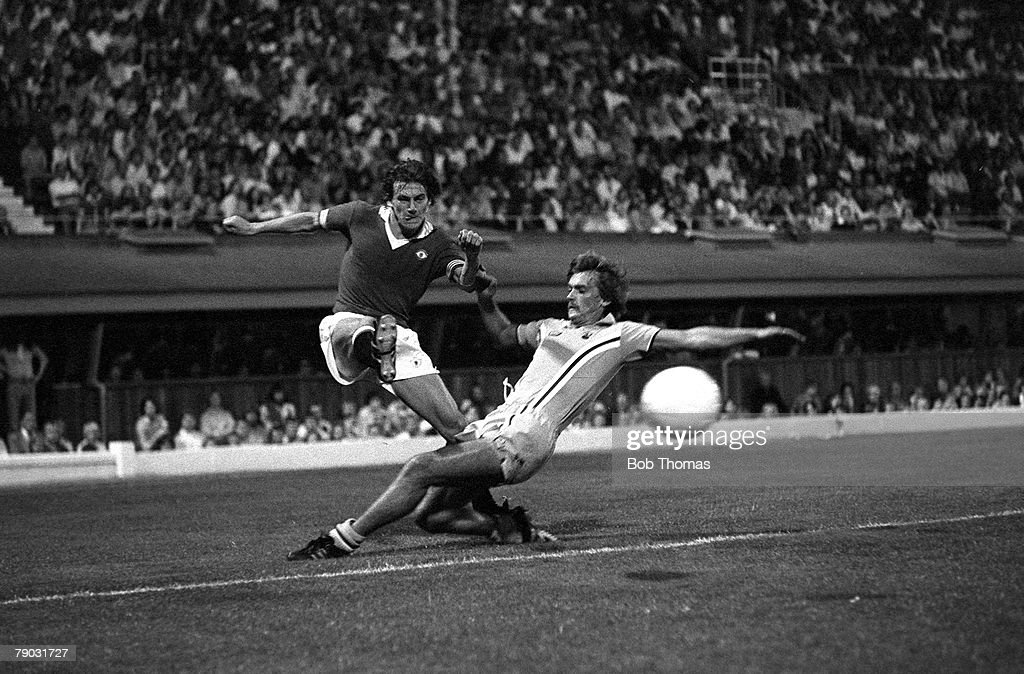 Football August 1976 Coventry City v Manchester United Manchester Uniteds Steve Coppell crosses the ball past Coventrys Jimmy Holmes