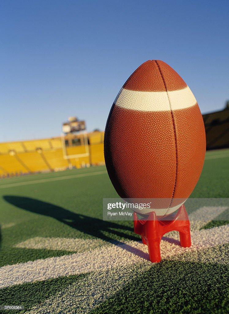 Football Balanced on a Tee : Stock Photo