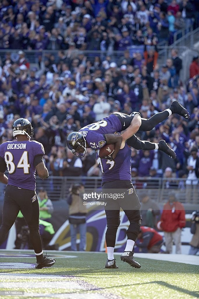 Baltimore Ravens Marshal Yanda (73) victorious, carrying Torrey Smith (82) on field during game vs Cincinnati Bengals at M&T Bank Stadium. Simon Bruty F562 )