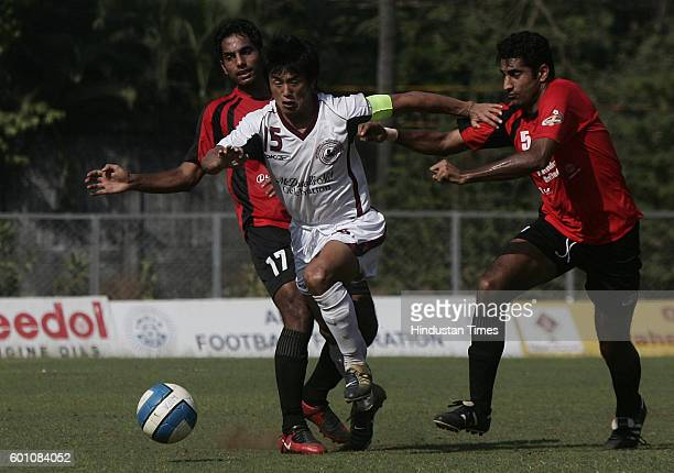 Football Bhaichung Bhutia of Mohun Bagan fights for the ball against Sukhvinder Singh and Harpreet Singh of Mahindra United at ONGC India...