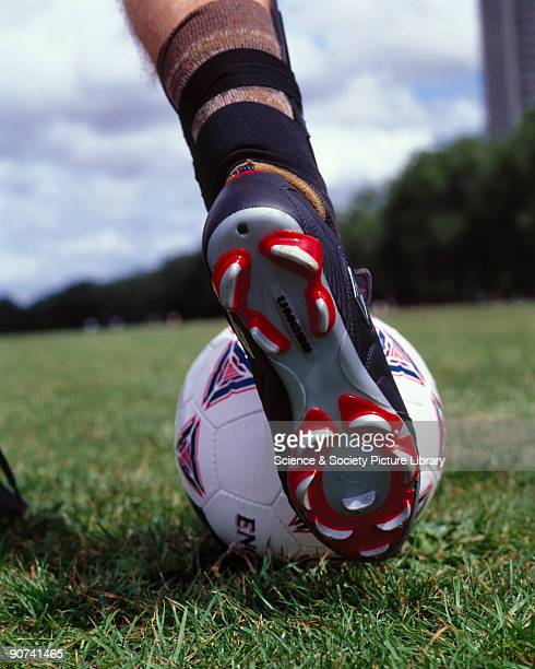 A football boot about to strike a ball October 2000