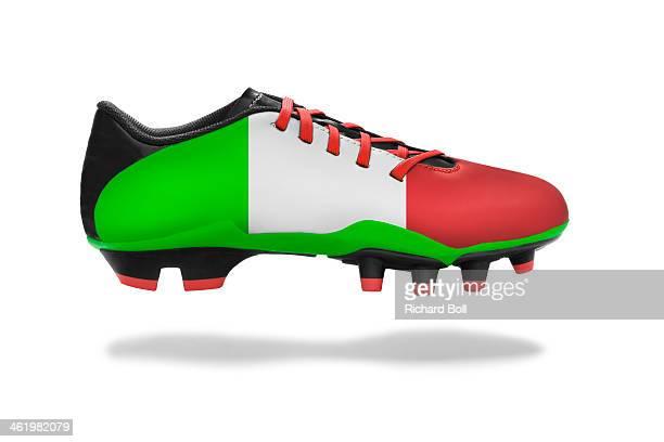 A football boot with an Italian flag design